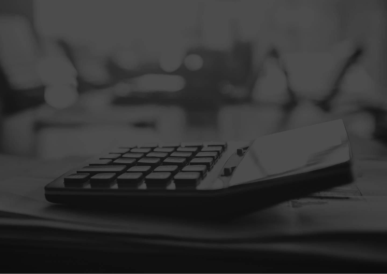 Close up calculator on business working desk, dark background concept.